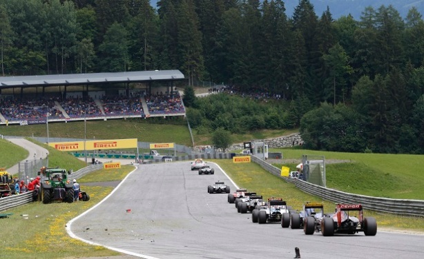 Red Bull Ring, Spielberg, Austria. Sunday 21 June 2015. The Safety Car leads the field as Marshals clear the scene of the crash between Kimi Raikkonen, Ferrari SF-15T, and Fernando Alonso, McLaren MP4-30 Honda. World Copyright: Alastair Staley/LAT Photographic. ref: Digital Image _R6T5880