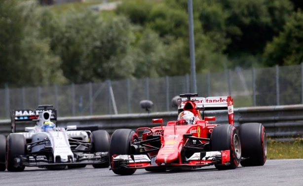 Red Bull Ring, Spielberg, Austria. Sunday 21 June 2015. Sebastian Vettel, Ferrari SF-15T, leads Felipe Massa, Williams FW37 Mercedes. World Copyright: Alastair Staley/LAT Photographic. ref: Digital Image _R6T5991