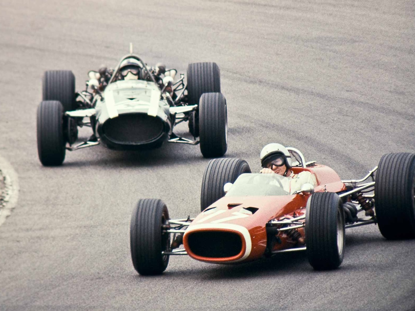 Bruce in m4b brm ahead of pedro rodriguez cooper t81 maserati it was the debut of the lotus 49 ford clark won the race in chapman s jewel